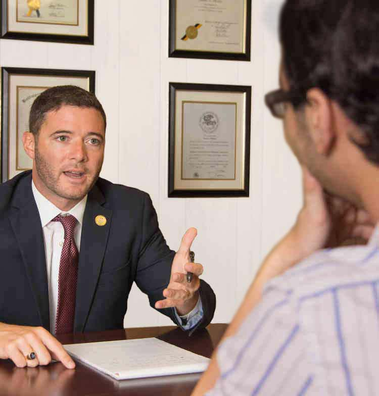Personal injury attorney Christian Miele talking with a client