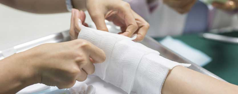 A nurse wrapping a burn injury patients' hand in Maryland.