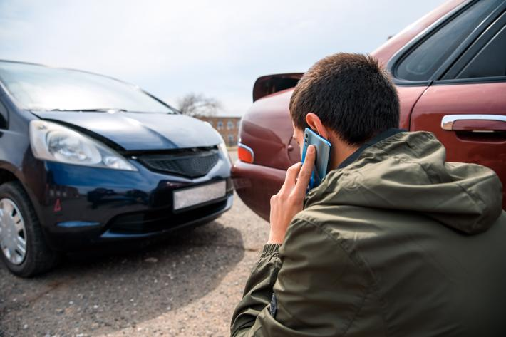 A man on the phone with a Maryland car accident attorney after being rear-ended.