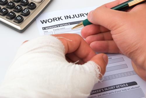 An injured worker filling out a claim form.